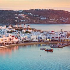 #TravelTuesday Inspiration - Mykonos Greece! Situated in the midst of the famous Cyclades islands Mykonos is world-famous for its white sandy beaches crystalline waters and glamorous nightlife. It is one of the most visited tourist destinations in Greece offering visitors a wealth of entertainment opportunities from dance clubs and diners to theatre and upscale dining. Though by taking a look at the photo you can figure out why visitors flock to this gorgeous island. Would you go?  #ocean…