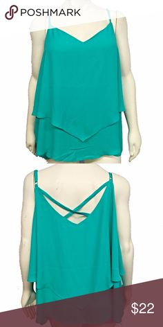 🆕Torrid Turquoise Cami This is a gorgeous double layer cami from torrid. Criss cross back. Adjustable spaghetti straps. Drapey, chiffon material. New with tags, never worn. Comes from a smoke and pet free home. No damage, perfect condition. It is a torrid size 5 which is the equivalent of a 5X. torrid Tops Camisoles