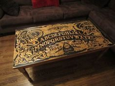This table is seriously bad-ass. It's a handmade Ouija Board Coffee Table. Have a séance in your living room while you watch The Walking Dead or even Unique Coffee Table, Coffee Table Design, Creative Coffee, Coffee Tables, Diy Ouija Board, Furniture Makeover, Cool Furniture, Vintage Furniture, Furniture Ideas