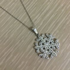"""Snowflake Necklace Thin silver chain, snowflake pendant. Received as a gift, just do not wear often enough to keep. Ready for someone else to love! Necklace size 19.5"""". Jewelry Necklaces"""