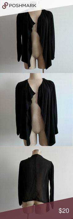 """Vince Camuto black cardigan Vince Camuto black cardigan with ruched sleeves. Size S. Small hole under arm. Other excellent condition. Smoke free home. Sleeves & Front body: 96% rayon, 4% spandex. Back body: 100% polyester. Length (from shoulder): 27"""". Length (from underarm): 13"""". Chest: 17"""". See last pic for flaw. Vince Camuto Sweaters Cardigans"""