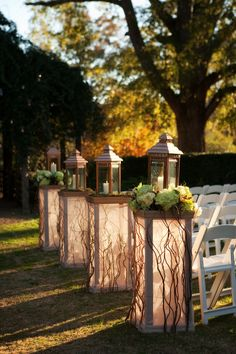 Love the lantern. driftwood. floral combo.