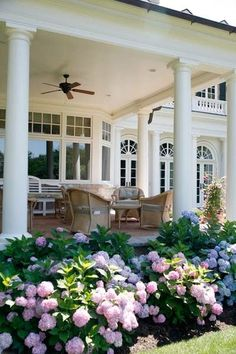 Beautiful porch and hydrangeas, hostas, daylilies, & clematis.