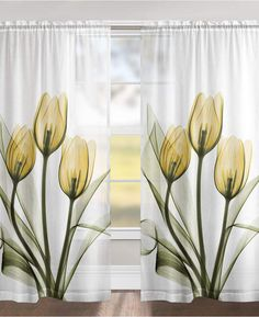 """The calming, floral image of Laural Home's """"Golden Tulips"""" sheer window panels features a unique technique using an x-ray machine on a cluster of yellow tulips. #tulips #yellowdrapes #drapes #sheercurtains #afflnk #funkthishouse"""