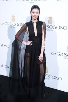 Ming Xi in a Spring/Summer 2016 pleated chiffon cape dress at the De Grisogono Party during the 69th Annual Cannes Film Festival.