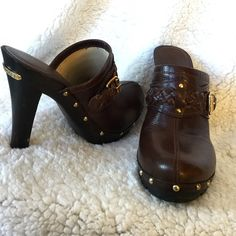 """Gorgeous Brown Leather Braided MK Clogs Gorgeous Brown Leather Braided MK Clogs Minor Wear but EXCELLENT CONDITION! The beautiful brown leather upper is adorned with leather braiding, brass buckle and attached to the espresso colored soft wood with brass studs. Brass Michael Kors Plate affixed to the back of heel.  Rubber Soles for easy walking and comfort.  Heel Height-4 3/4 Platform Height-3/4"""" Heel Width-3/4"""" Michael Kors Shoes Heels"""