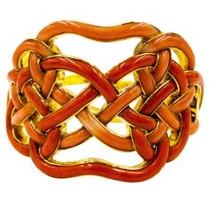 Angela Cummings  for Tiffany Rare Coral Gold Knot Motif Bracelet | From a unique collection of vintage cuff bracelets at https://www.1stdibs.com/jewelry/bracelets/cuff-bracelets/