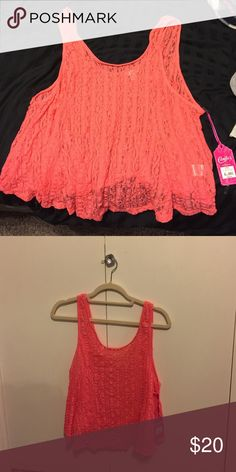 Crop top Pink/coral colored crop top. Lace like material. Brand new never worn. Still has tags. Candie's Tops Crop Tops