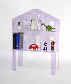The latest addition to Kartell is a set of translucent, minimal, candy-coloured plastic doll's houses created by Fabio Novembre. Check it out on today's post http://petitandsmall.com/ultra-minimal-villa-dollhouse-kartell/