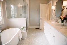 master bathroom interior design by Kerry Spears Interiors featuring a white bathroom and marble tile