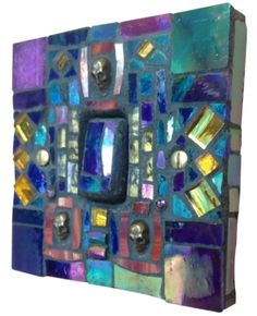 Light switch in blues and pinks. Hand crafted in Murano and Tiffany stained glass,   Size 9 x 9 x 1.5 cm. Size 9 x 9 x 1.5 cm. Please feel free to send me a message on Pinterest for commissions.