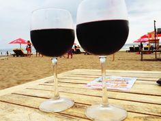 Drinking red wine at the beach sunset time Seminyak Bali