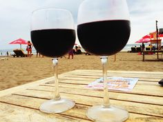 Drinking red wine at the beach sunset time Seminyak Bali