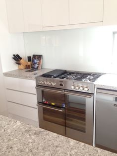 White and stainless steel, showcased in a sleek, modern, contemporary design for the Sterling cooker & oven!