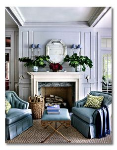A gorgeous vignette to sit by the fire - Find out how to ditto this look via interior designer @fieldstonehill