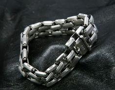 Custom linked silver bracelet by Matt Booth, Room 101 Brand Lifestyle.