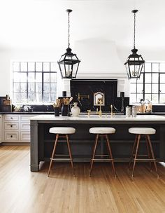 This bistro-style space is the perfect mix of old-meets-new with a dark marble backsplash and French lanterns. Nate Berkus, Kitchen Interior, Interior Design Living Room, Kitchen Decor, Kitchen Ideas, Kitchen Layout, Kitchen Designs, Beautiful Houses Interior, Beautiful Homes