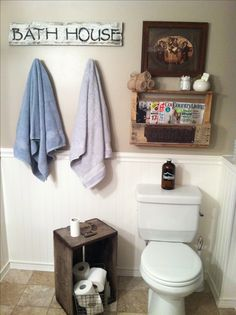 Rustic bathroom decor... DIY barn wood sign...pallet shelf... Reclaimed wood