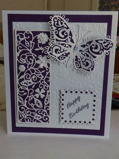Tattered lace panel matted onto purple card and attached to card with foam pads. Description from docrafts.com. I searched for this on bing.com/images