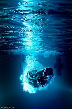 Competitive swimmer entry dive, underwater from the starting blocks.