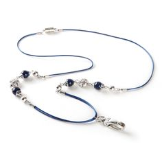 Inspired by the mystical night skies and the mysterious depths of the oceans, this 'Lapis' ID holder is sure to complement just about any work outfit including scrubs and chic skirt suits. The dark blue colored lanyard necklace is decorated with a brilliant design that consists of a unique arrangement of lapis lazuli stones and silver-toned accents. For your convenience, this high end badge hold is completed with a large metal hook clasp which holds and displays your ID card or acces...