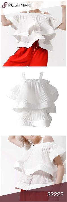 """🆕 Eggshell White Flowing Ruffle Gorgeous Top ‼️ PRICE FIRM ‼️ 10% DISCOUNT ON 2 OR MORE ITEMS FROM MY CLOSET ‼️   Layered Ruffle Top Retail $127  NEW WITH TAGS  Simply spectacular. Gorgeous pleated ruffles everywhere!!!!! Eggshell white. This can tie in front or back and look equally as fabulous. 75% cotton 25% polyester. This will fit anywhere from small to large.   One Size Bust 44"""" Length 22"""" Tops"""