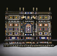 An Italian gilt-bronze-pietre dure-and marble-mounted ebony and ebonised cabinet, Roman, mid 17th century.