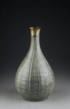 12th C. Korea Ceramic; celadon glaze, gold Bottle six sections with floral motifs.11 7/8 x 6 3/4 in.