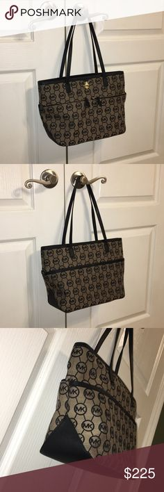 Flawless Michael Kors tote NWOT! This monogram tote is flawless inside and out. A great size for an everyday purse or to use as an occasional tote.  Material is canvas. Lots of zipper pockets.   Make me an offer! I'm open to ALL offers! Michael Kors Bags Totes