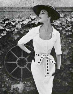 White cotton summer dress with black polka-dot gros-grain sash by Lanvin-Castillo, photo by Pottier, 1953