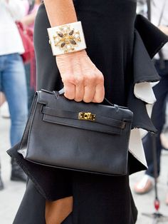 Fall 2013 Couture Week Street Style: Anna Dello Russo, wearing a Chanel bracelet