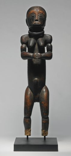 Fang Female Reliquary Figure, Gabon | collected in 1925| Sotheby's - The present Fang female statue from the Kunin collection is a rare example of a reliquary figure depicted in an upright standing position, and is exceptional in its scale and artistic quality.