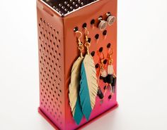 5-Minute DIY: Turn a Cheese Grater Into an Earring Caddy. Great thrift store hack for earring display.