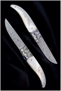 AVR knives (Aad van Ryswyk) | Liner lock folder with Mother of Pearl handle and Golden Titanium pins. The blade is made from stainless ladder pattern Damascus steel. Bolsters are made of fantasy Damascus. Hand carved and blue anodized Titanium. This knife won the first price on the DKE ( Dutch Knife exhibition ) in 2008 as 'Best Folder'. Photograph by Danny van Ryswyk.