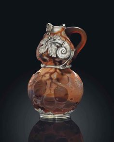 A silver-mounted glass ewer The silver mounts, marked lorie, with the maker's mark of Egor Cheryatov, Moscow, 1908-1917; the glass, by Emile Gallé, circa 1900