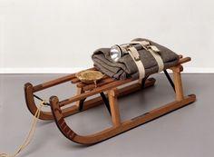 Joseph Beuys, Sled, 1969, wooden sled, felt, fabric straps, flashlight, fat, oil paint, string. COURTESY MITCHELL-INNES & NASH