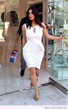 cf3c0c73010 Kim Kardashian Cocktail Dress - Kim Kardashian sheathed her curves in a  tight-fitting white peplum dress with a cleavage-baring keyhole neckline  for a trip ...