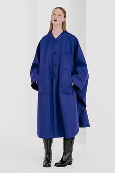 HYKE!! Oversized is always my go-to look. Especially when I'm feeling sluggish and bloated. I love how this coat can look like a buttoned up sweater. Can be paired with any shoe, for whatever any occasion you like. This electric blue colour is amazing against any skin tone