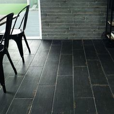 The SomerTile 8.25x23.5-inch Lambris Negre Porcelain Floor and Wall Tile is a grain finished tile that gives a distressed wood look. This tile enhances any design with its worn wood stamps and minor veining within the soot black glaze.