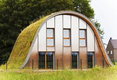 La maison vague: a wave shaped house with a vegetated roof and ideal thermal insulation, so there is less energy dissipation | house . Haus . maison | Architect: Patrick Nadeau |