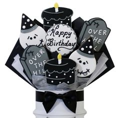 One year older, one year wiser and officially over the hill! Wish them a happy birthday and welcome them to the over the hill club with this fun cookie bouquet made with our delicious hand-decorated shortbread cookies. Each arrangement features a birthday skeleton, black and white birthday cake and over the hill tombstones.     7 Cookies     Center Cookie can be personalized for FREE.