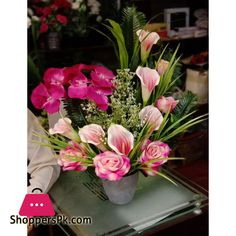 Buy Beautiful Artificial Flower Pot Arrangement at Best Price in Pakistan Table Flower Arrangements, Table Flowers, Artificial Flowers, Flower Pots, Tulips, Planting Flowers, Brown Converse, Beautiful, Pakistan