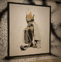 Banksy niño con hambre