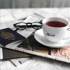 McCafe Travel Instagram @FilipaJackson ..................................... #flatlay #flatlays #flatlayapp #styling #photography #instagram #passport #mcCafe #mcdonalds #travel #coffee #tea #newspaper #mens #marble #table #playingwithapparel #rayban #glasses