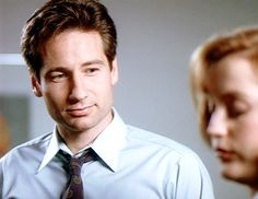 1.02. He already loves her. In one episode Mulder say that he doesn't gaze at Scully. He is definitely is gazing at her.