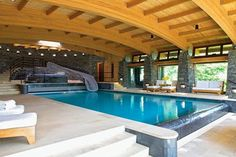 After this week of gray-ish days, the weekend's arrival is more than welcome. Though my personal tastes usually lean toward the simple and rustic when it comes to vacation homes, I'm indulging in some high-end escapism by staring at this over-the-top indoor pool grotto, built into a Vermont hillside.