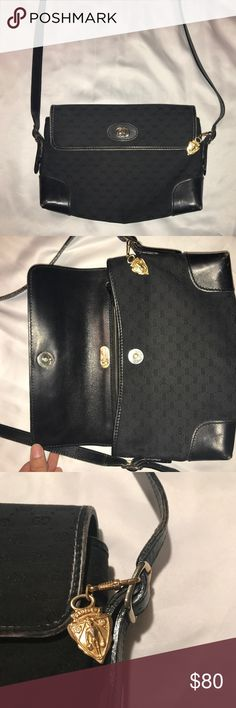 Authentic Gucci Purse Guaranteed authentic Gucci purse. Used, slight wear on edges, but can easily be touched up. Black on black classic GG print with gold detailing. This sleek and compact bag is a great addition to any outfit. Check out my other items for luxury items for your closet. Asking $80, but accepting offers. Gucci Bags