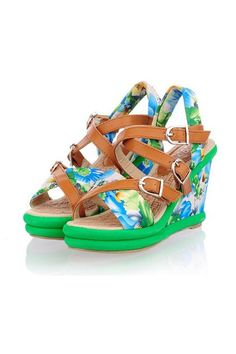 The sandals crafted in PU, featuring wrapped pin buckle details, floral print to wedge, bright color to hemline, ankle strap with pin buckle fastening.