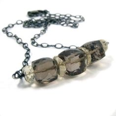 Re-pin this Oregon Sunstone and Smoky Quartz Necklace for a chance to win it! You have from Monday through Friday morning at 8 am Mountain time (02/17/12), then we will pick a winner for one of this week's items