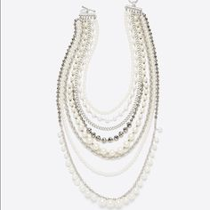 "Ann Taylor Pearlized Crystal Statement Necklace This can't-miss power piece makes an unforgettable statement with tiers of lustrous pearlized beads, sparkling crystals and metallic chains for a look of infinite polish. Toggle clasp. 32"" length.  I've only worn this once. Ann Taylor Jewelry Necklaces"